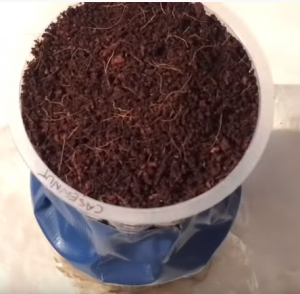 attaching one cup on top of another with tape